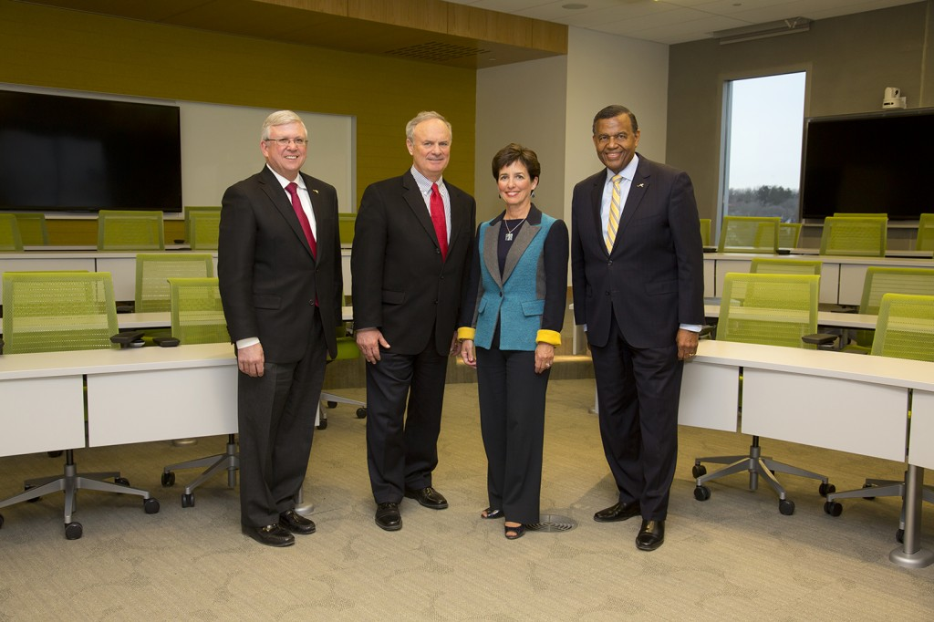 From left: Bloch School Acting Dean David Donnelly, classroom donors Terry and Peggy Dunn, and UMKC Chancellor Leo Morton.