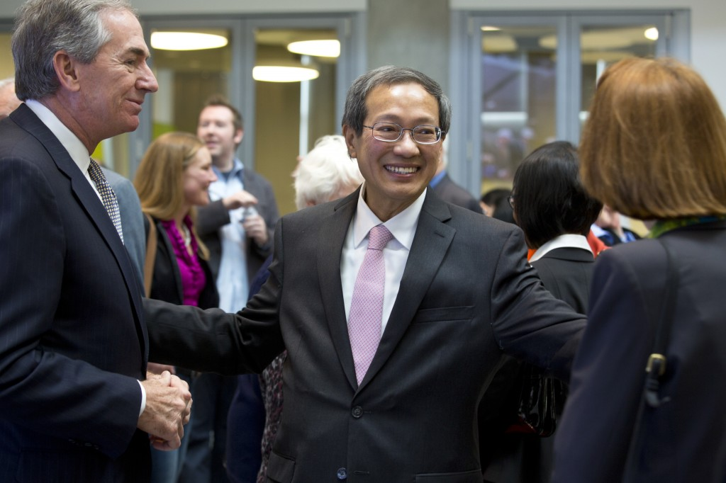 Dr. Teng-Kee Tan greets Gary Forsee, former president of the UM System and guests at the dedication event.