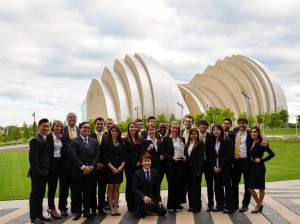 The UMKC 2013 Enactus Team with faculty advisor Cary Clark in front of one of Kansas City's many iconic locations.