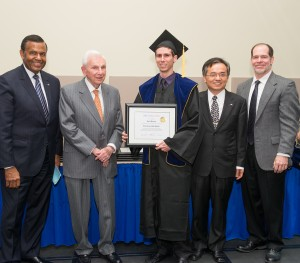 UMKC Chancellor Leo Morton, Henry Bloch, EScholar graduate, Michael Song and Mark Parry.