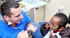 Entire dental school clinic devoted to free dental care for KC area children on 'Give Kids A Smile' Day