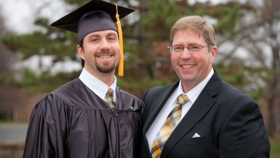 Graduate Daniel Q. Smith and his father, Tim Smith. 