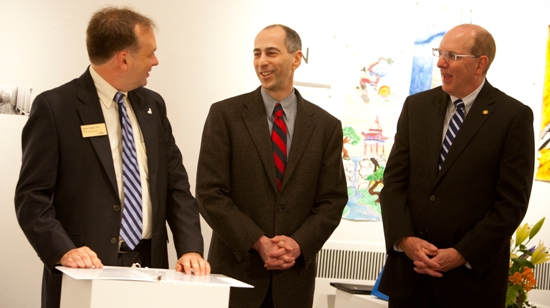 Michael Kruger, (center), recently received a surprise award: the University of Missouri System President's Award for Citizenship-Leadership. Kruger is the chair of the Physics and Astronomy Department. The award was presented by College of Arts and Sciences Dean Wayne Vaught (left) and UM System President's Chief of Staff Bob Schwartz (right).