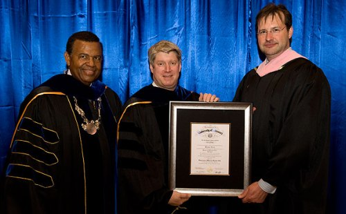 Kansas City Symphony Music Director Michael Stern (center) stands with UMKC Chancellor Leo E. Morton (left) and UMKC Conservatory of Music and Dance Dean Peter Witte (right) after receiving an honorary doctorate from the UMKC Conservatory of Music and Dance.