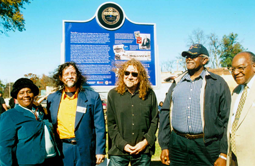 Key figures in the Mississippi Blues Trail project, which was aided by UMKC's Marr Sound Archives, stand near the Tutwiler Blues Trail marker. From left are Tutwiler Mayor Genether Miller-Spurlock; Blues Trail research chairman Jim O'Neal; rock superstar Robert Plant; former Tutwiler Mayor Robert Grayson; and state Sen. David Jordan. Photo by Panny Flautt Mayfield.