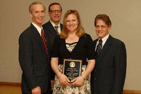 Pictured with Libby Stoddard are (from left to right) Ron MacQuarrie, Dean, School of Graduate Studies (UMKC), Steven Graham, Vice President (UM System) and Robert Stein, Executive Director (Missouri Department of Higher Education)