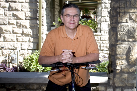 Professor Robert Prue enjoys riding his bicycle to campus. Prue joined the University of Missouri-Kansas City School of Social work in July.